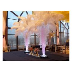 The ostrich feathers are quality plume feathers, they fluffy. Perfect for any centerpiece/decoration. In the centerpieces in the pictures have 40 feather per centerpiece. Bling Centerpiece, Ostrich Feather Centerpieces, Banquet Centerpieces, Lighted Centerpieces, Centerpiece Decorations, Floral Centerpieces, Wedding Centerpieces, Tacky Wedding, Silver Wedding Decorations