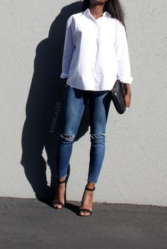 Minimal style | How to wear the white button down shirt casually while keeping it chic. Featuring Zara distressed skinny jeans, heeled sandals and holographic clutch, and ASOS shirt. By African / black blogger and model Iman.  http://www.manigazer.com/wear-white-shirt-casually/