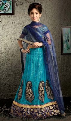 Own your favorite celebrity looks dressed up in this girls lehenga choli in net, shaded blue color. The lace work seems to be chic and fantastic for any celebration. Upon request we can make round front/back neck and short 6 inches sleeves regular lehenga blouse also. #TurquiseAndBlueColorNetAlineCholi