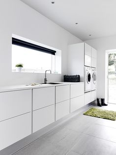 Sleek and modern white laundry #whitelaundry #whitecabinets