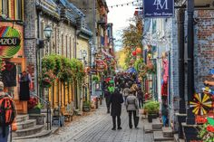 Old Quebec has such an amazing charm! Basse Ville (Lower Town) looks like a typical European city, with all those historical buildings, paved alleys, flowers, restaurants and cute shops with handmade articles. And if you visit it during autumn, it's simply lovely! The colors are unbelievable, just like a postcard! Old Quebec, Canada, North America, Places To Go, City, Restaurants, Buildings, Pictures, Shops