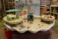 Beach themed miniature garden. we used multiple layers, sand and shells to create this large fairy garden