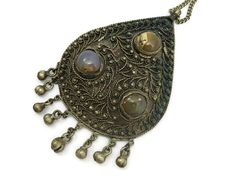A vintage Boho pendant necklace, with a bell fringe, and three agate stone cabochons. No marks. Pendant is about 4 long including the fringe, the