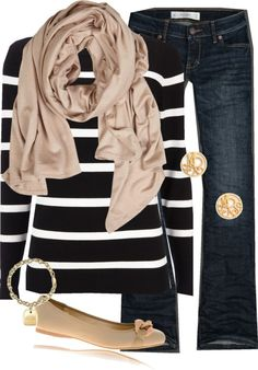 Jeans, black and white striped sweater, and a scarf and flats in the same color.