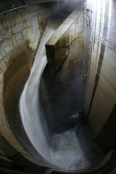 Overflow water caused by a heavy rain flows into a water tank at the Metropolitan Area Outer Underground Discharge Channel in Kusakabe, north of Tokyo. (Photo credit: REUTERS / Ministry of Land, Infrastructure, Transport and Tourism - Edogawa River Office)