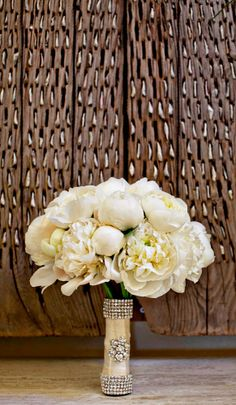 White bouquet with bling wrap.