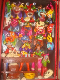 "A ""RETABLO"" A WELLKNOWN HANDCRAFT FROM PERU-AYACUCHO. THEY ARE BEAUTIFUL WOODEN BOXES WITH REPRESENTATIONS OF DIFFERENT ACTIVITIES OF LIFE. THEY STARTED TO BE DONE DURING THE COLONIAL PERIOD -XVI-XVII CENTURY- REPRESENTING MAINLY RELIGIOUS SCENES."