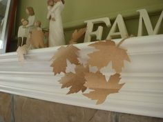 paper bag leaf garland. Same technique as a paper doll chain but with a leaf.