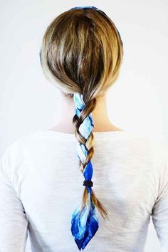 Use a headscarf as your third chunk of hair, incorporating it into your braid.   15 Ways To Up Your Braid Game
