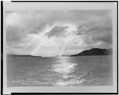 View of the San Francisco Bay before the Golden Gate Bridge was built with sun shining through clouds on water, c1902. (Library of Congress) #