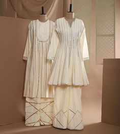White Lustre: Refresh your festive wardrobe staples with elegant classics from Gulabo by Abu Sandeep. Shop the collection at Pernia's Pop-Up Studio, Woodburn Court, Elgin Road, Kolkata. We ship worldwide! Stylish Dresses For Girls, Stylish Dress Designs, Simple Dresses, Casual Dresses, Girls Dresses, Simple Pakistani Dresses, Pakistani Dress Design, Pakistani Outfits, Indian Outfits