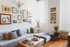 """12 Gallery Wall Styles for Any Space - The """"Sentimental Value"""" Wall: This gallery wall made use of the couple's existing art and photos for an eye-catching living room display. The yellow and gold tones in the frame collection are mirrored in other parts of the apartment with their <a href=""""https://www.homepolish.com/mag/some-old-some-new?gallerize=aca3b0af"""" target=""""_blank"""">National Geographic collection</a>. - @Homepolish San Francisco"""