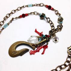 A personal favorite from my Etsy shop https://www.etsy.com/listing/216017629/red-coral-native-wood-fish-hook-necklace