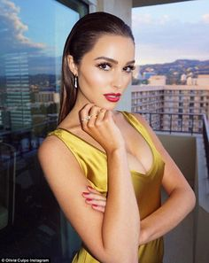 Sleek and striking: Following the sleek lines of the dress, Olivia's hair was styled so th...