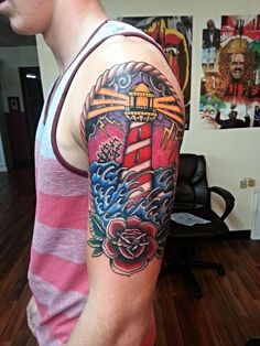 Picturesque Lighthouse by Brian Spitz - http://www.tattooideas1.org/placement/arm/picturesque-lighthouse-by-brian-spitz/