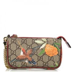 This is an authentic GUCCI GG Supreme Monogram Tian Print Mini Chain Bag in Red. This petite, stylish chain bag is crafted of Guccissima GG monogram coated canvas with a complimentary red leather trim.