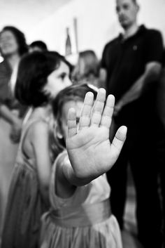 Talk to the hand… Christening in Andros, Greece. Photography by Shoothebride.