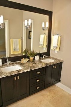 Mega Greige paint, espresso cabinets, framed mirror. Love this for