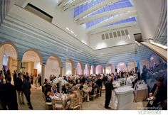 """Wedding reception in the Rapoport Atrium surrounded by Teresita Fernandez's, """"Stacked Waters."""""""