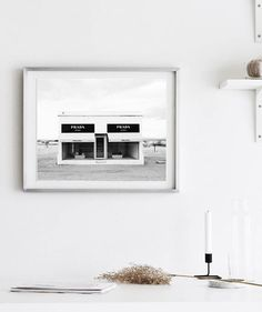 Prada Marfa is an iconic work of public art created by artists Elmgreen and Dragset, located in the Texan Desert. Prada Marfa has become a landmark of the modern fashion and art culture. Our black & white photography of the sculpture is a must-have staple every fashionable person