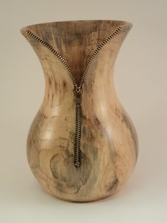 Pecan Vase with zipper. 8 inches tall.  www.bowlweevilwoodturning.com