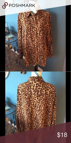 Karen Scott Leopard Printed. Blouse, SZ 2X Karen Scott Brown animal printed button down blouse with long sleeves fitted n the shoulders loose from there longer length hem, loose and flowing lots of movement to the fabric in excellent like new condition Karen Scott Tops Blouses