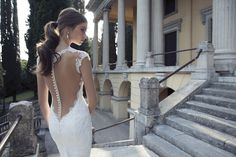 pearl backed wedding dress by @BERTA (love the chic ponytail too!)