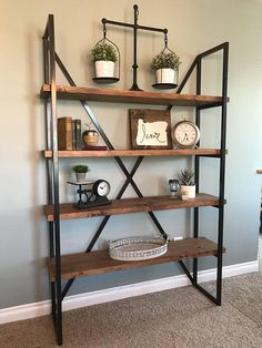 Let this gorgeous shelving unit be the focal point of your home. Made from tube steel frame, this piece has cross braces covering the back to provide rock solid stability and stunning looks. Industrial Shelving Units, Modern Shelving, Reclaimed Wood Bookcase, Wood Shelves, Interior Design Living Room, Modern Interior Design, Modern Bookcase, Industrial Furniture, Design Industrial