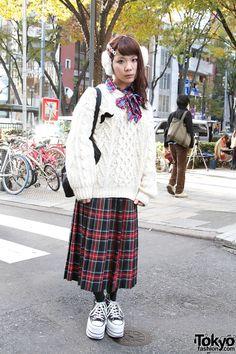 Friendly 19-year-old Japanese girl in oversized Kinji sweater in Harajuku.