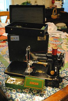 Vintage Singer Featherweight Sewing Machine.  Bought myself one of these today.  Merry Christmas to me!