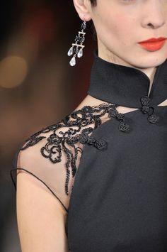 Ralph Lauren, Fall 2011, detail. Cheongsam inspired, high collar, flower buttons on the placket, cap sleeves