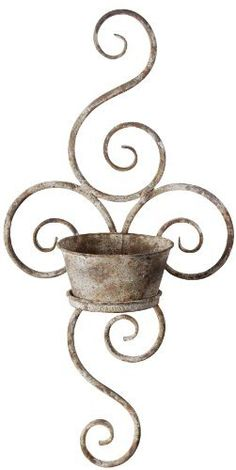 Esschert Design USA Aged Metal Wall Planter: The aged metal finish of this wall planter is a perfect addition to your outside decor. The beautiful scrolled design will look great on any wall. Metal Wall Planters, Fallen Fruits, Wrought Iron Decor, Aging Metal, Esschert Design, Iron Work, Metal Crafts, Metal Walls, Potted Plants