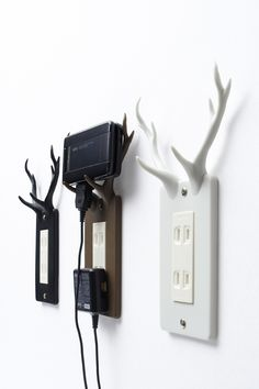 Socket Deer by Nendo - Cute and quirky electrical outlet covers that let you store your mobile phone as it recharges.