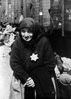 An elderly Jewish woman stands on the loading ramp at Auschwitz Concentration Camp near Oswiecim, Poland, 1943/1944. Photo: Deutsche Fotothek / Archive - NO WIRE SERVICE