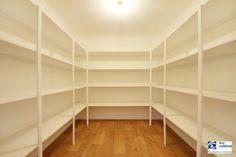 Huge walk-in linen cupboard.