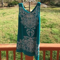 ❤️Beautiful teal shirt w small sliver studs❤️ ❤️Beautiful teal shirt w small sliver studs❤️ too small for me, no stains or fading, ready for summer☀️ B.L.E.U Tops Tank Tops