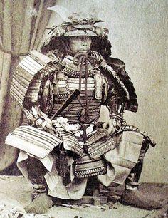 Samurai holding a tessen fan.