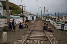 Rare photos of life in North Korea  -  March 13, 2017:     North Korean people rest next to the railroad tracks in a town in North Korea's North Hamgyong province.