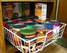 Pull out wire drawer in cabinet used for holding canned goods {featured on Home Storage Solutions 101}