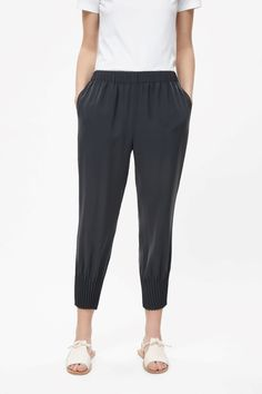 With pleated hems creating a tapered leg, these trousers have has a slight dropped crotch and an elastic waistband. Designed to sit just above the hips, they're completed with has subtle in-seam pockets and raw-cut finishes. Harem Pants, Pajama Pants, Drop Crotch, Wish Shopping, Trousers Women, Personal Style, Sweatpants, Clothes, Black