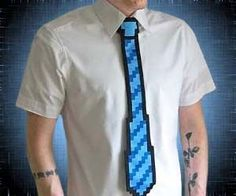 Blend the real world with the 8 bit world with this fun pixelated 8 bit shirt tie. The 8 bit tie comes in blue or red and has jagged edges that remind us of a simpler time when graphics were pixelated and an italian plumber named Mario was all the rage.