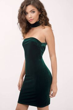 Cute green bodycon dress that features a choker neckline is perfect for any holiday party.