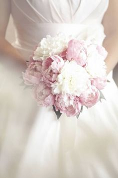 Pink and white peonies- not sure if i like all peonies but I like the fluffiness.  Maybe with rose accents?