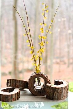 If you have pieces of unused firewood lying around your backyard, try sanding them to create these stylish vase holders.0