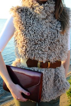 fluffy vest and leather belt