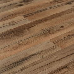 7.6-in W x 4.23-ft L Tavern Oak Laminate Wood Plank Flooring from Style Selections from Lowe's Canada