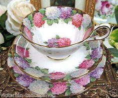 tea cup, saucer, and cakes plate