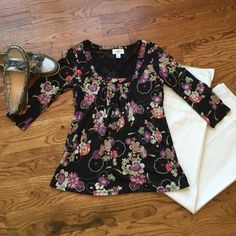 Top with 3/4 length sleeves! Ann Taylor Loft!  Really flattering Ann Taylor Loft Top with 3/4 sleeves. Beautiful pattern, pleated front. Tag has line through it as seen in picture. Very comfortable. Worn once. Sz M. Great condition. Ann Taylor Tops Blouses