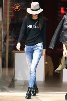 "Her sweater may say ""hello,"" but the model was saying ""arrivederci"" to Milan... #refinery29 http://www.refinery29.com/2014/09/75407/kendall-jenner-model-outfit-inspiration#slide-11"