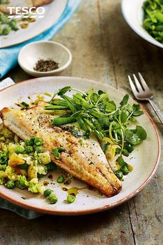 Grab a speedy fish dinner with this pan-fried sea bass recipe. Pan-frying is super quick and gives the fillets crisp, golden skin - delicious with a simple side of crushed potatoes and peas plus a fragrant tarragon salad. | Tesco